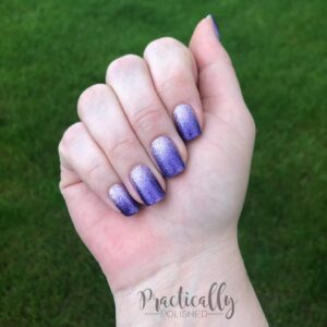 Hand wearing a Purple Ombre Nail Polish